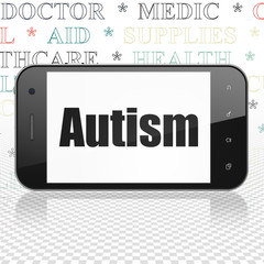 Healthcare concept: Smartphone with  black text Autism on display,  Tag Cloud background, 3D rendering