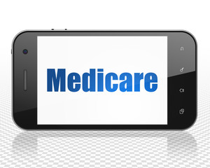 Medicine concept: Smartphone with blue text Medicare on display, 3D rendering