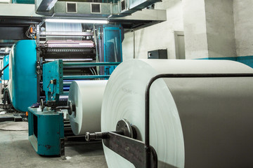 Big rolls with white paper ready to print.