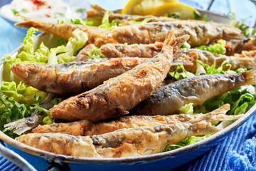 Traditional Greek crispy fried sardines in batter