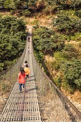 Children Running over Suspension Bridge, Trishuli River, Nepal