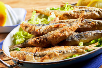 Plate of fried sardines, pilchards or anchovies