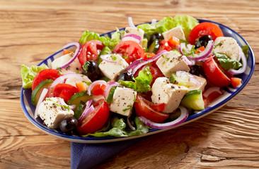 Dish of healthy fresh Greek salad with feta cheese