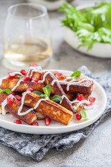 Crispy Halloumi cheese sticks Fries with yogurt sauce, pomegranate seeds and mint