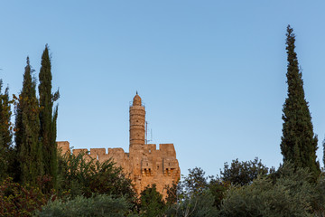 Round tower on citadel of King David at sunset