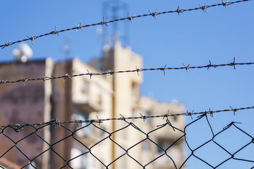 Photo of barbed wire on blurred background during day