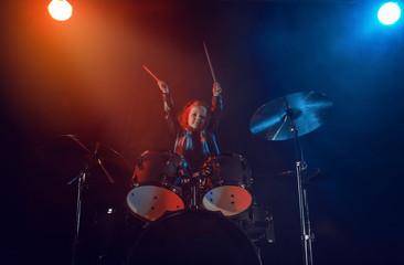 A little drummer girl.