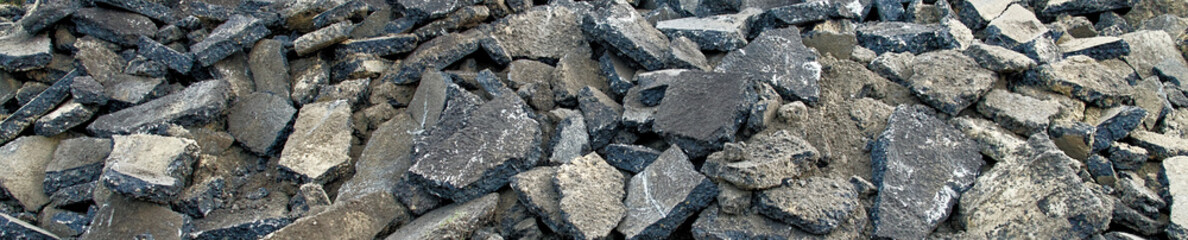 Panoramic view of a stockpile with asphalt piles, which are prepared on the heap for removal to orderly disposal.