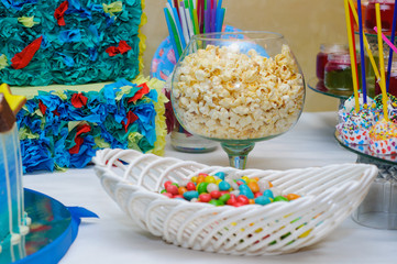 Candy Bar. Great bowl of popcorn. Basket with colored candies.