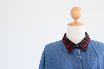 Fashion photo of mannequin wearing denim shirt display background with copy space