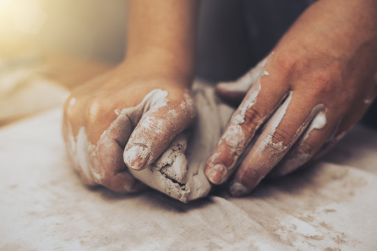 Female potter works with clay, craftsman hands close up