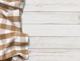 table with brown picnic cloth top view background
