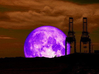 super full purple moon back mountain and silhouette crain at seaport