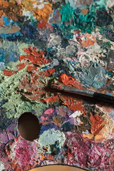 Mixed paint and paintbrush on palette