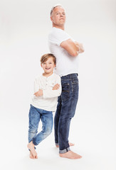 Father and son posing in studio