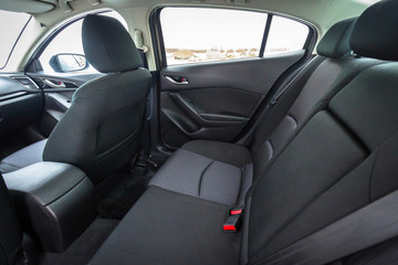 Black car interior with back seats