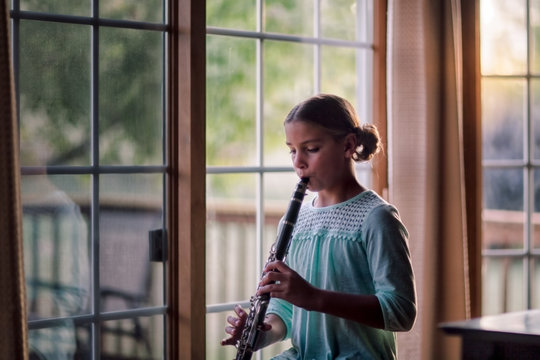 Young clarinettist playing her clarinet