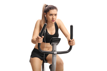 Woman exercising on a cross-trainer machine
