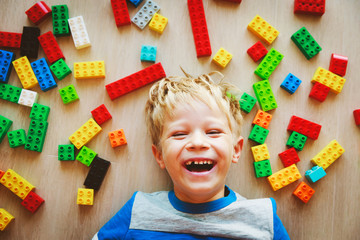 cute little boy love playing with plastic blocks