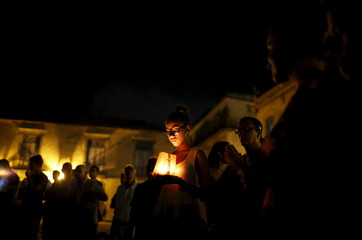 Catholic faithful gather during a prayer vigil in front of Havana's cathedral