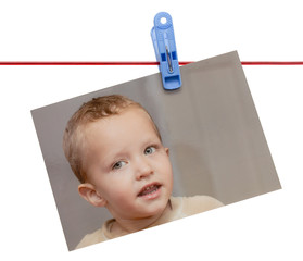photo boy on a rope with a clothespin on a white background
