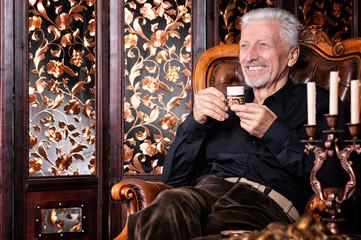 smiling senior man drinking coffee