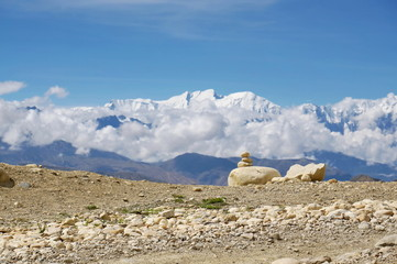 Beautifully stacked stones against the backdrop of the Annapurna mountain range. Upper Mustang. Nepal.