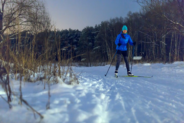 Image of woman skiing in park