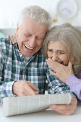 senior couple with newspaper