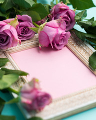 Happy Mother's Day, Women's Day, Valentine's Day or Birthday Flat Lay Background. Beautiful wooden vintage picture frame, fresh pink roses and copy space.
