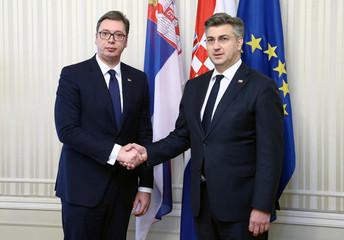 Croatia's Prime Minister Andrej Plenkovic shakes hands with Serbia's President Aleksandar Vucic in Zagreb
