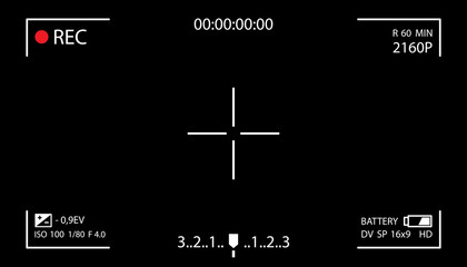 Camera screen with white frame, figures and battery symbol. Camcorder viewfinder on black background.