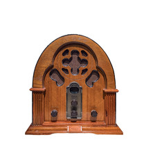 Vintage wood radio from 1930 isolated with a white background.Antique model cathedral.