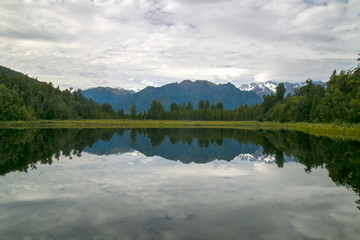 Calm pure lake in mountains of Southern Alps, New Zealand