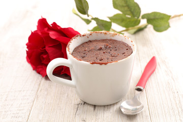 delicious chocolate cake mug and red rose