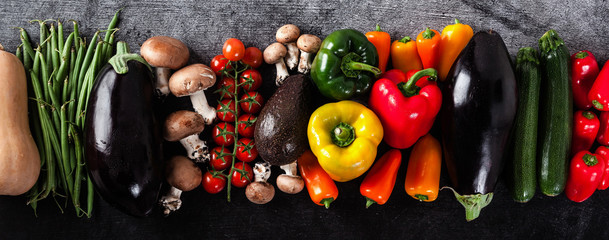 banner of fresh vegetables on the table, bright multi-colored organic bio production. concept of...
