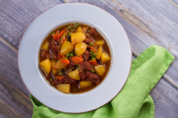 Beef meat stewed with potatoes, carrots, peas and spices. Beef stew, popular dish in Ireland
