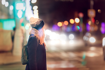 Portrait of a girl in the night city lights