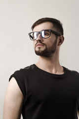 closeup. confident modern man looking over his glasses