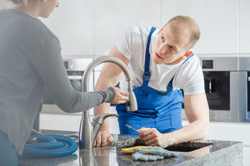 Woman talking to plumber