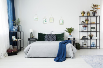 Blue bedroom interior with posters