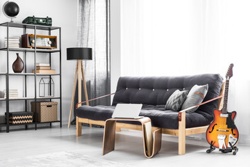Wooden sofa with black futon
