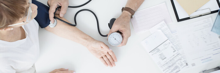 Doctor measuring patient's pressure