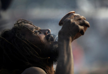 A Hindu holy man, or sadhu, drinks water at the premises of Pashupatinath Temple on the eve of Shivaratri festival in Kathmandu