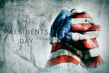 hands with flag of US and text presidents day