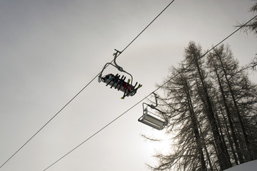 A ski lift and a cable car in the alps switzerland in winter