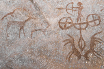A hunting scene on the wall of the cave. ancient hunters. archeology. era. stone Age.