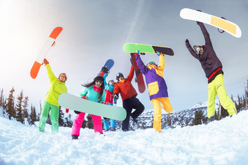 Six happy friends is having fun. Ski or snowboard concept
