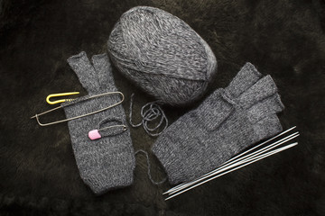 knitting woolen mittens, gloves without fingers, warm winter accessory