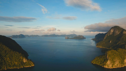 Tropical bay in El Nido. Aerial view: bay and the tropical islands. Tropical landscape. Sky and mountains rocks. Seascape:sky, mountains, ocean.Philippines, El Nido. Travel concept